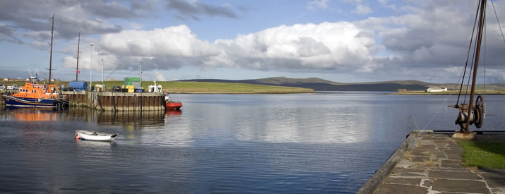 Stromness harbour. Stromness is a picturesque waterfront town in the Orkney Islands and the port of MV Hamnavoe, NorthLink's ship which sails from Scrabster on the Scottish Mainland